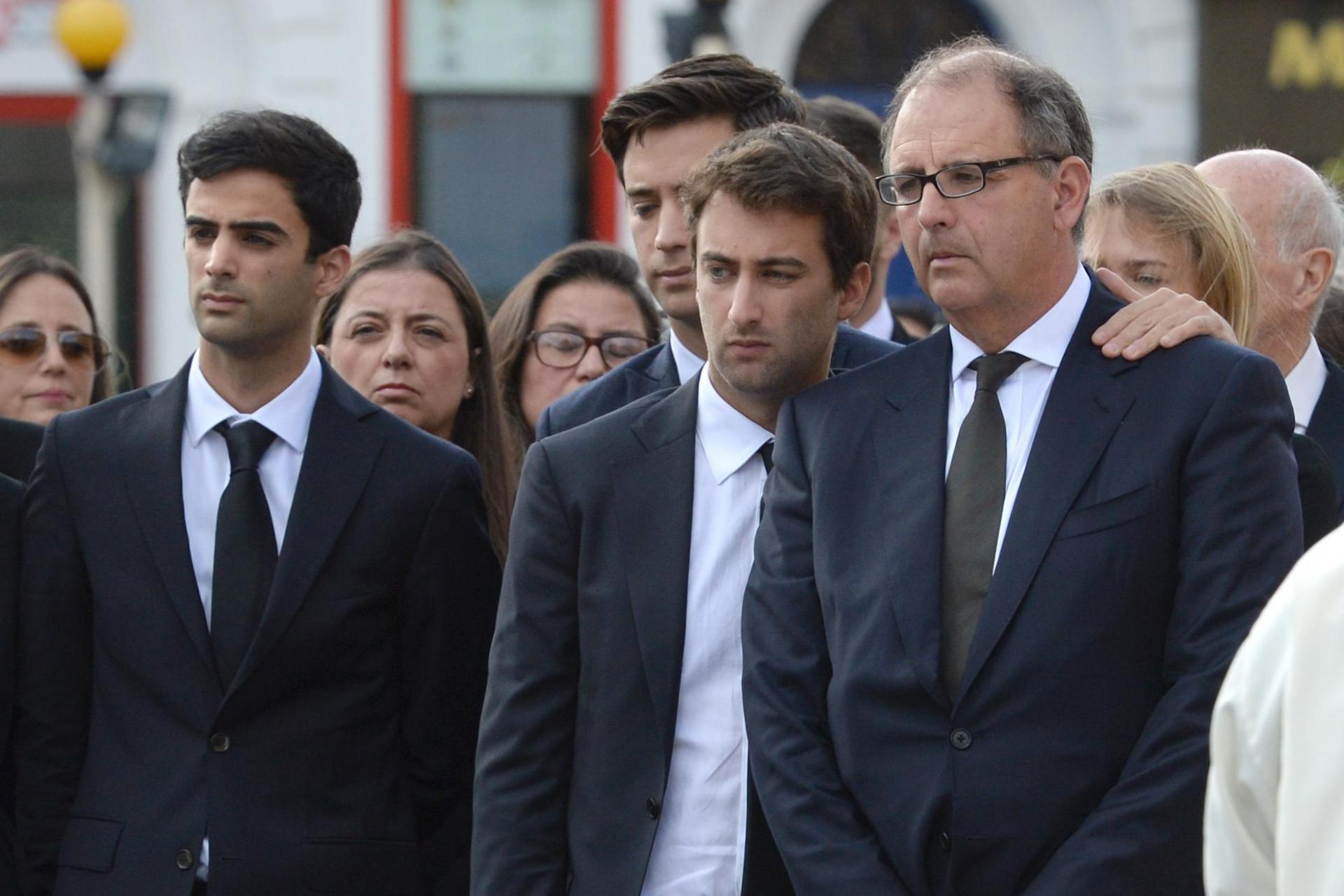 Daphne Caruana Galizia's husband and sons grieve during her funeral in November 2017. Photo: Matthew Mirabelli