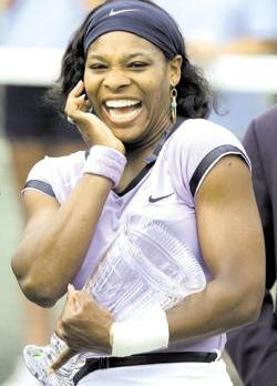 Serena Williams with the winner's trophy after the Family Circle Cup final last weekend.
