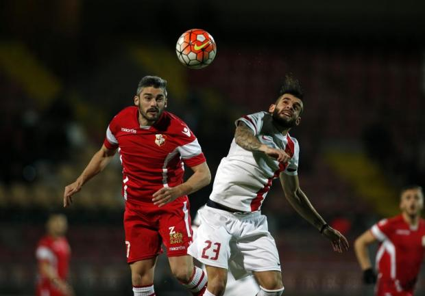Naxxar Lions' Eduardo Vallecillo (left) and Valletta's Claudio Pani challenge for a high ball during their Premier League football match at the Hibs Stadium in Corradino on March 1. Photo: Darrin Zammit Lupi
