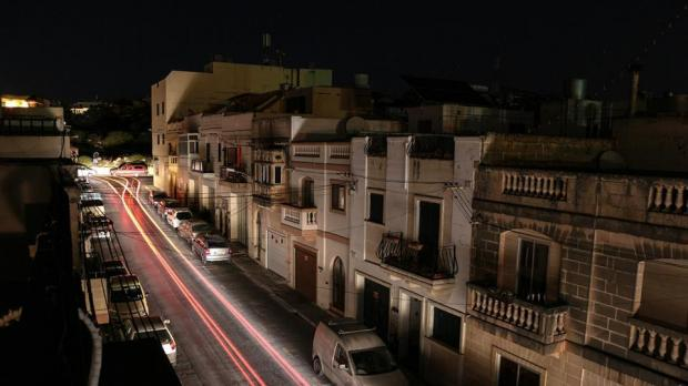 A slow shutter shot of a street in Iklin during the blackout, using car lights and the full moon. Picture - Simon Scicluna - mynews@timesofmalta.com