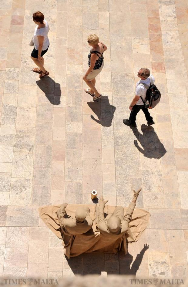 A couple of street performers pose as statues in Valletta's Republic Street on May 18. Photo: Chris Sant Fournier