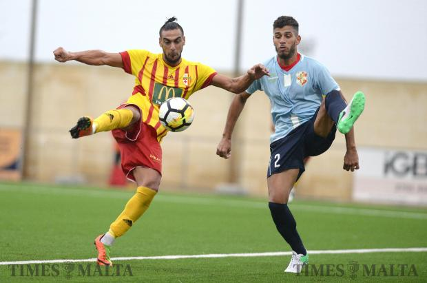 Birkirkara's Waldemar Jesus Acosta Ferreria (left) tries to get a shot past Naxxar Lions' Rafael Santos Henriques Caetano during their BOV Premier League match at the Centenary Football Stadium in Ta'Qali on February 3. Photo: Matthew Mirabelli