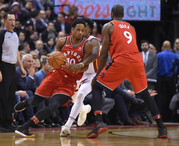 Toronto Raptors guard DeMar DeRozan (10) dribbles the ball around Miami Heat guard Josh Richardson (0) and Raptors forward Serge Ibaka (9) in the first half at Air Canada Centre. Photo: Dan Hamilton-USA TODAY Sports