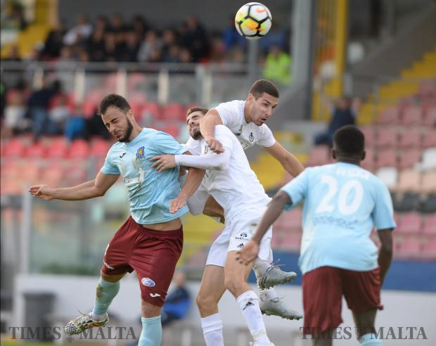 Players from Gzira and Sliema clash in the air during their BOV Premiership match at The Hibernian's Stadium in Paola on November 25. Photo: Matthew Mirabelli