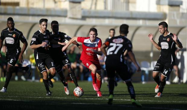 Pembroke's Gibson Bardsley (centre) tries to make his way thorugh the Qormi defence during their Premier League football match at the Tedesco Stadium in Hamrun on November 21. Photo: Darrin Zammit Lupi