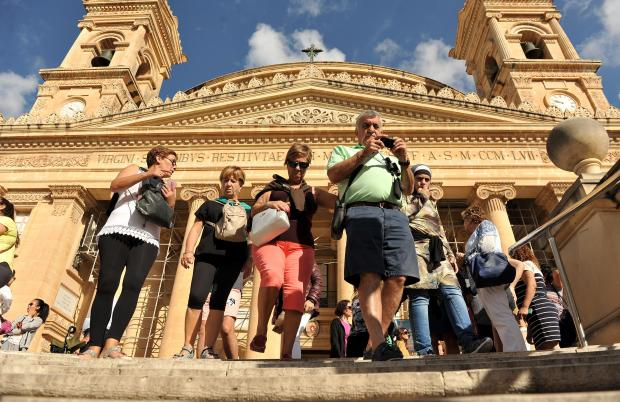 Tourists exit the Mosta church on October 11. Photo: Chris Sant Fournier
