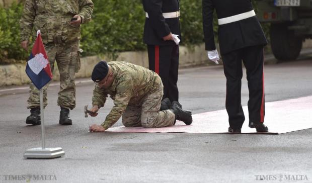An Armed Forces of Malta soldier prepares the red carpet before the arrival of Queen Elizabeth at San Anton Palace in Attard on November 26. Photo: Mark Zammit Cordina