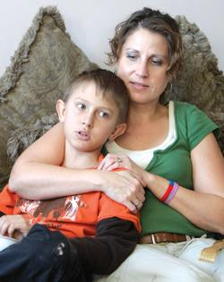 December 14, 2010: Donna Hisey holding her son Tanner in the family home near Clyde, Ohio. Photo: AP