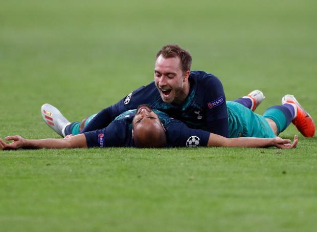 Tottenham's Brazilian forward Lucas celebrates after scoring a goal with teammate Christian Eriksen.