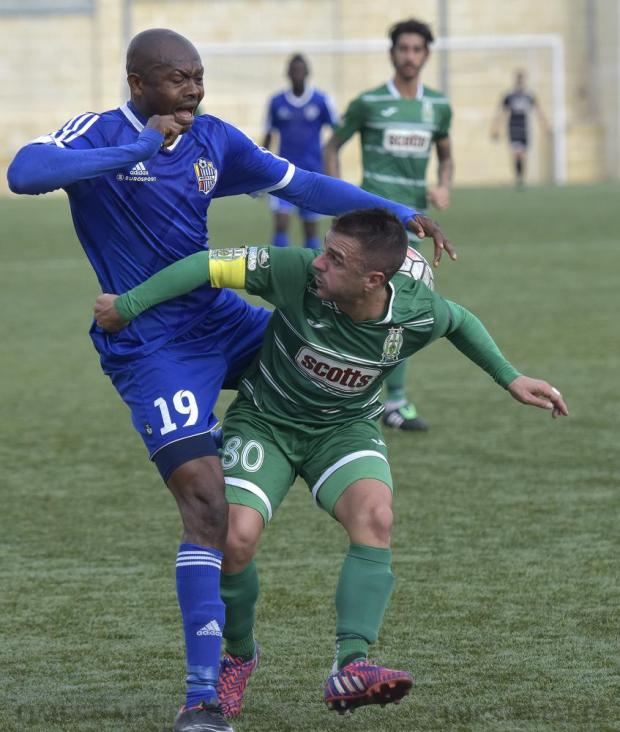 Mosta's Ice Cream Guobadia (left) and Floriana's Nicolas Chiesa fight fort the ball during their Premier League football match at Tedesco Stadium in Hamrun on November 23. Photo: Mark Zammit Cordina