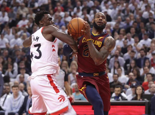 Cleveland Cavaliers forward LeBron James (23) drives to the basket against Toronto Raptors forward Pascal Siakam (43) in game two of the second round of the 2018 NBA Playoffs at Air Canada Centre. The Cavaliers beat the Raptors 128-110. Photo Credit: Tom Szczerbowski-USA TODAY Sports
