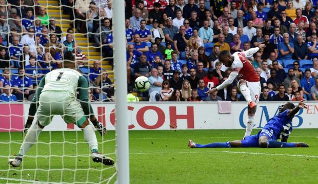 Arsenal's Alexandre Lacazette scores their third goal.