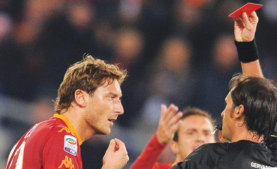 You're off... Roma captain Francesco Totti is shown the red card by referee Andrea Gervasoni.