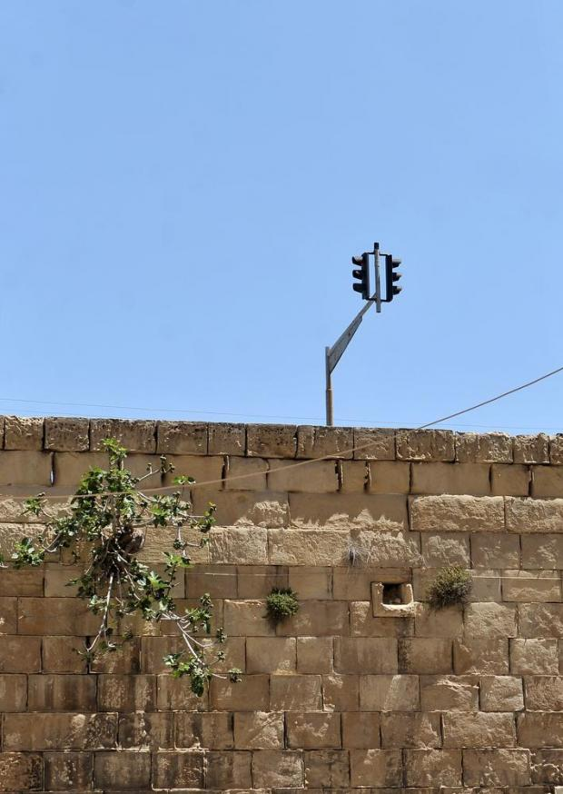 A traffic light pops up from behind a bastion in Valletta on May 18. Photo: Chris Sant Fournier