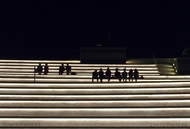 People relax on the steps of the SmartCity Laguna on July 10. Photo: Darrin Zammit Lupi