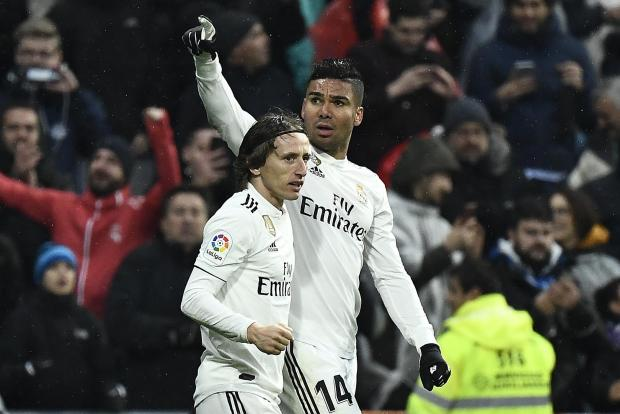 Real Madrid's Casemiro celebrates his goal with team-mate Luca Modric.