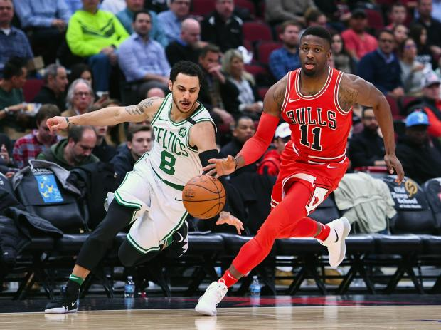 Boston Celtics guard Shane Larkin (8) steals the ball against Chicago Bulls forward David Nwaba (11) during the second half at the United Center. Photo Credit: Mike DiNovo-USA TODAY Sports
