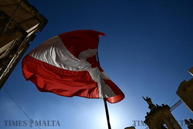 A flag flies in Valletta on Good Friday on April 14. Photo: Jonathan Borg