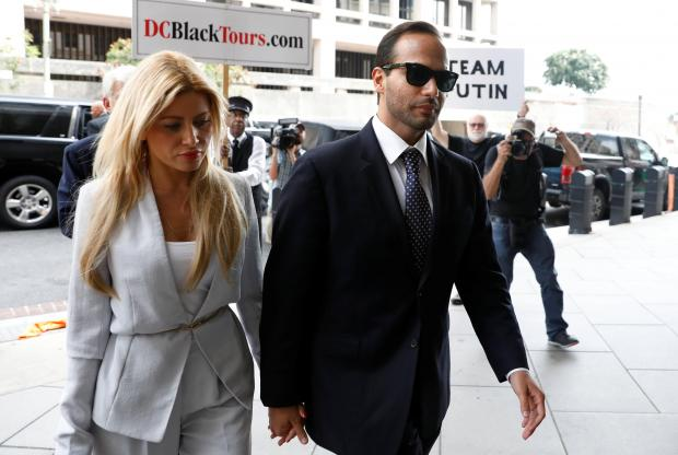 Mr Papadopoulos enters court accompanied by his partner. Photo: Reuters