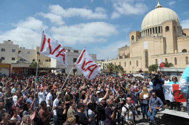 Hunters celebrate in Qormi with IVA flags on April 12, after winning the referendum to let them continue hunting migrating birds in spring. Photo: Matthew Mirabelli