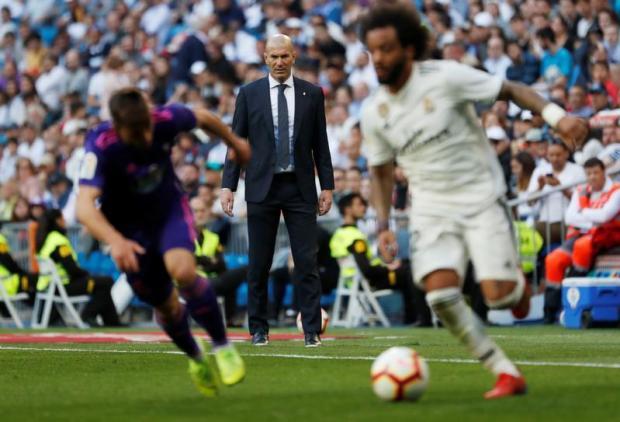 Real Madrid coach Zinedine Zidane looks on.