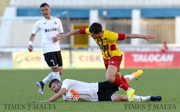 Dejan Boljevic, of Hibernians, goes down after a challenge by Srdjan Dimitrov, of Birkirkara during their Premiership match at the National Stadium in Ta'Qali on April 23. Photo: Matthew Mirabelli