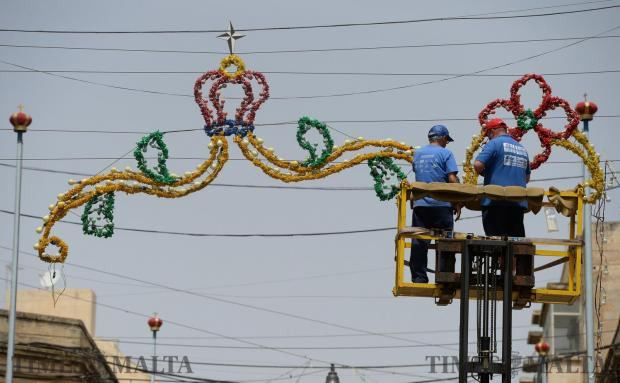Two men work on the festa preparations in Pieta on May 13. Photo: Matthew Mirabelli