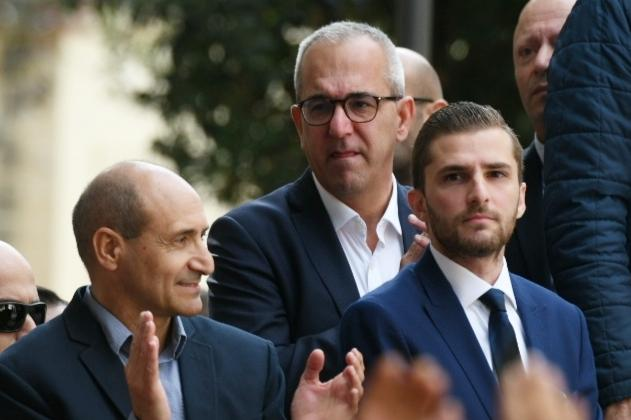 OPM head of customer care Sandro Craus (centre) with PL leadership contender Chris Fearne (left) Photo: Matthew Mirabelli