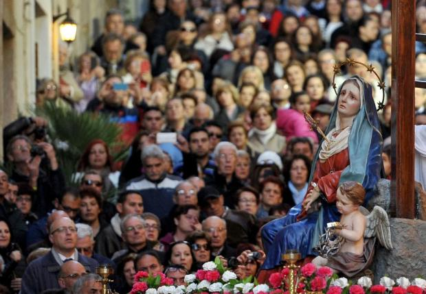Onlookers follow the statue of Our Lady of Sorrows at the Ta' Giezu procession in Valletta on March 18. Photo: Chris Sant Fournier