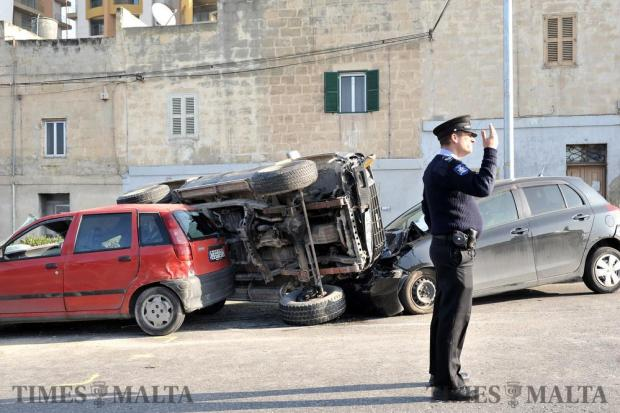 A policeman directs traffic around a road accident in Paola on February 16. Photo: Chris Sant Fournier