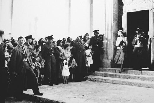 Princess Elizabeth leaving the Mdina Cathedral after a visit in 1949, accompanied by Archbishop Michael Gonzi.