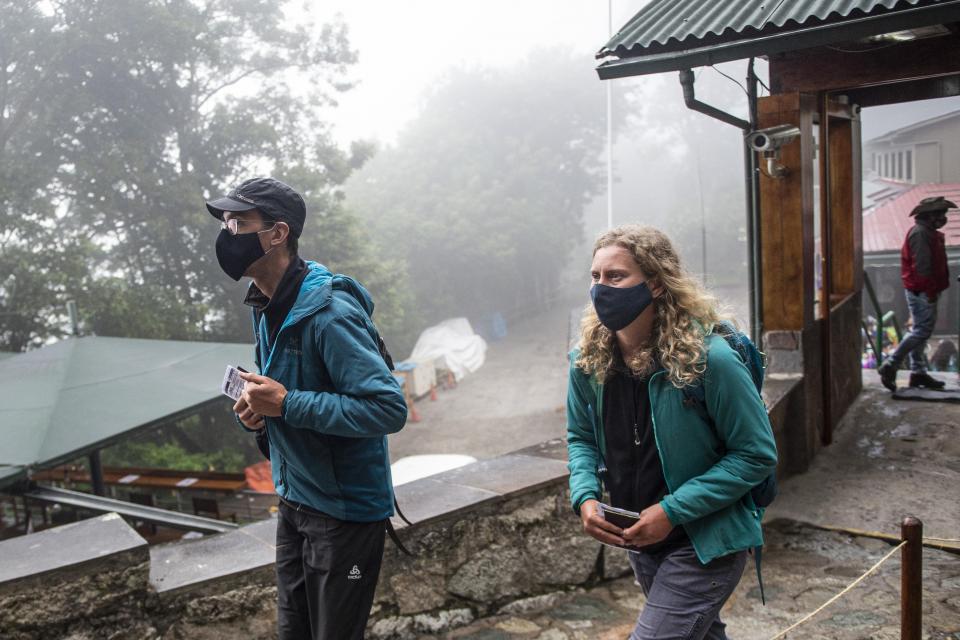 French citizens, Veronique and Arnaud, arrive to Machu Picchu, in Cusco, Peru.