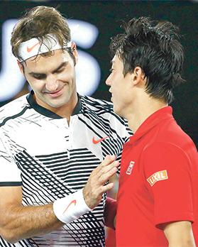 Roger Federer (left) and Kei Nishikori after their match.