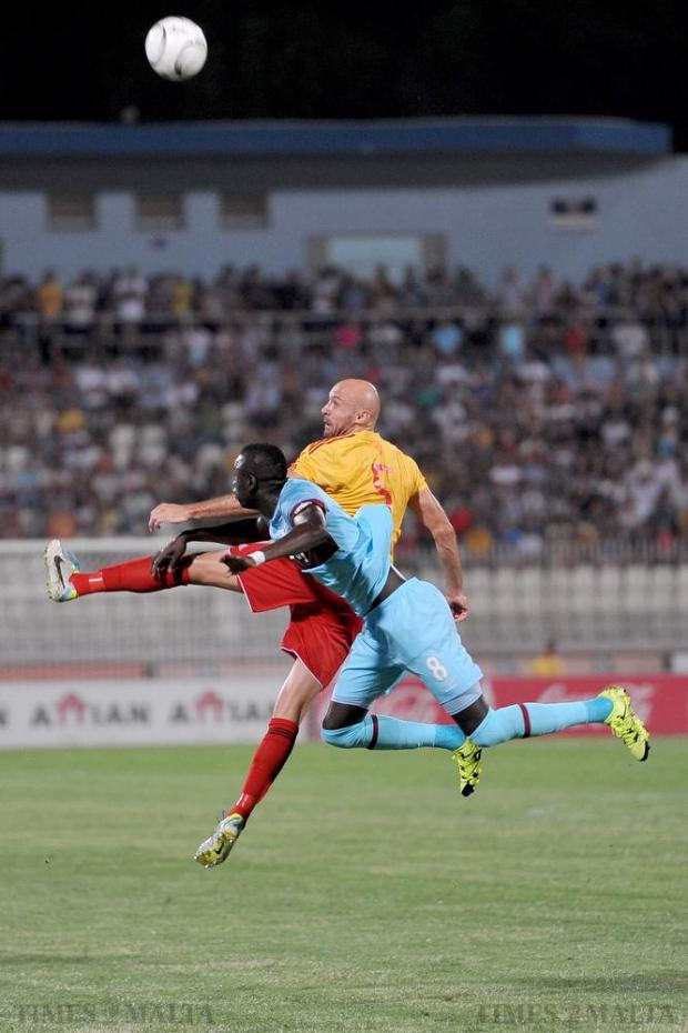 Birkirkara's Mauricio Mazzetti and West Ham's Cheikhou Kouyate leap for the ball during their UEFA Europa League qualifier at the National Stadium in Ta'Qali on 23 July. Photo: Chris Sant Fournier. Photo: Chris Sant Fournier