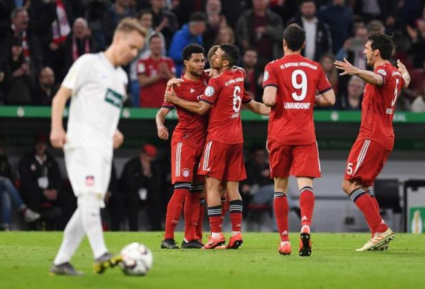 Bayern Munich players celebrate after one of their goals.