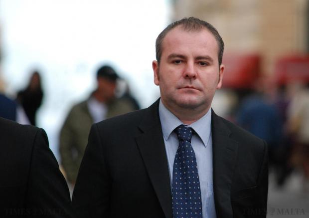 Stephen Smith on his way to court on December 10 to testify against Paul Sheehan, Emanuel Mallia's former driver. Smith told the court that he feared for his life when a man threatened him with a gun after he accidentally hit a parked car in Gżira. Photo: Mark Zammit Cordina