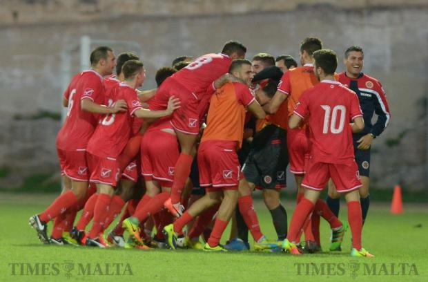 Malta U21 football team celebrate after Jean Borg scores the opening goal against Moldova during their UEFA U21 Championship group match at the Hibernians Stadium in Corradino on October 11. Photo: Matthew Mirabelli