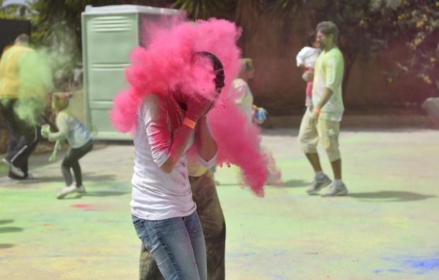 A girl has Pink coloured powder paint thrown at her during the Holi Festival organized by the Indian Community held in St Venera on April 06. Photo: Mark Zammit Cordina