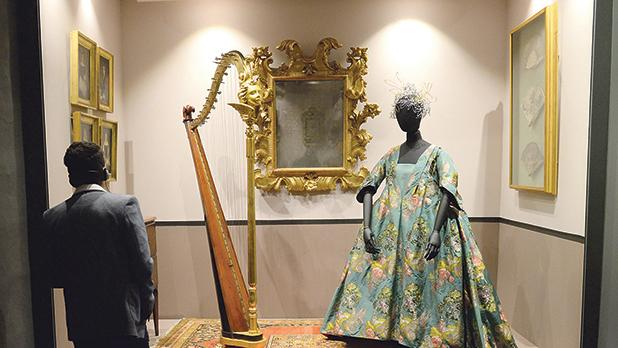 An 18th-century harp with a gilt cherub decoration and gilt claw feet is one of the many instruments on display at the Music in Malta – From Prehistory to Vinyl exhibition at the Mdina Cathedral Museum.