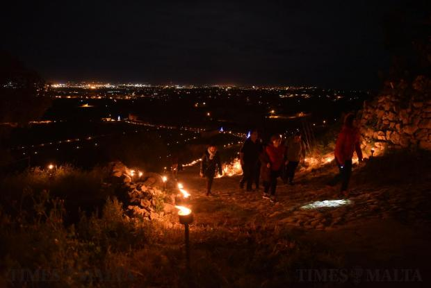 People walk up the hill leading to Laferla cross in Girgenti during Maundy Thursday on March 29. Photo: Mark Zammit Cordina