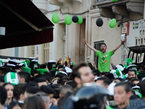 A noisy crowd gathers outside a bar in St Julian's for the celebrations of St Patrick's day on 17 March. Photo: Steve Zammit Lupi