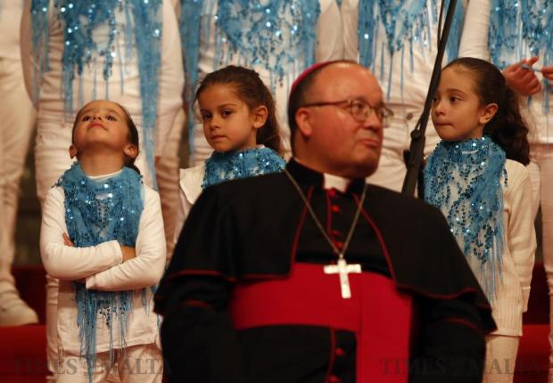 Choir children stand behind Archbishop Charles Scicluna during the opening of the annual Christmas event Milied Flimkien at Castille Place in Valletta on December 20. Photo: Darrin Zammit Lupi