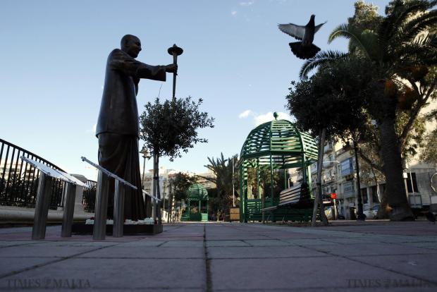 A pigeon flies past a statue of Indian guru Sri Chinmoy in Sliema on January 18. Intended as a symbol of peace, the recently-inaugurated statue on the Sliema promenade is the centre of controversy because of allegations surrounding the late Indian spiritual leader's cult-like practices. Photo: Darrin Zammit Lupi