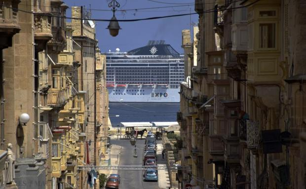 The cruise liner MSC Fantasia is seen from Valletta's Merchants Street as it sails out of Grand Harbour on August 26. Photo: Mark Zammit Cordina
