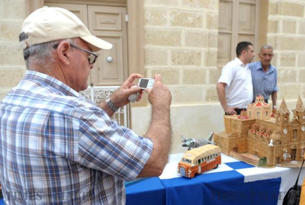 A man takes a photograph of a model of Zurrieq Parish church made of matchsticks at the Fish Festival on June 5. Photo: Matthew Mirabelli