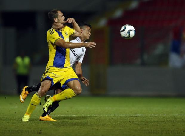 Jackson Lima (right) of Hibernians fights off a challenge from a Carlos García of Maccabi Tel Aviv during their Champions League second qualifying round match at Hibs Stadium on July 14. Photo: Darrin Zammit Lupi