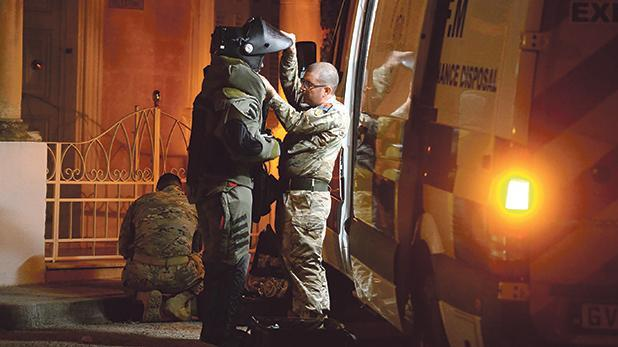 The bomb disposal squad close to the scene of the Balzan burglary on Friday.