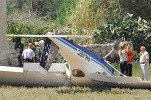 Pilots Adrian Vella Gera (centre) and Swiss national Melina Hunziker (left) who luckily escaped unhurt yesterday when their Tecnam P-92J Echo single engine plane crashed in a field in Luqa. The aircraft landed in the vicinity of a fireworks factory. Photo: Matthew Mirabelli.