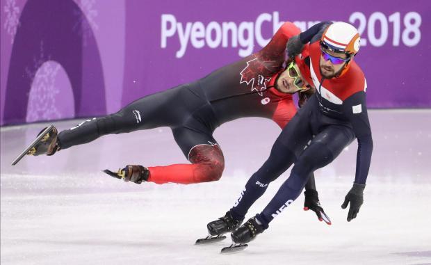Samuel Girard of Canada falls behind Sjinkie Knegt of Netherlands.