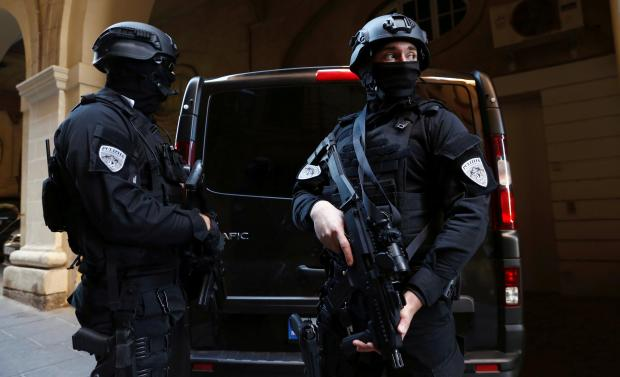 Security outside the court has been tight. Photo: Reuters